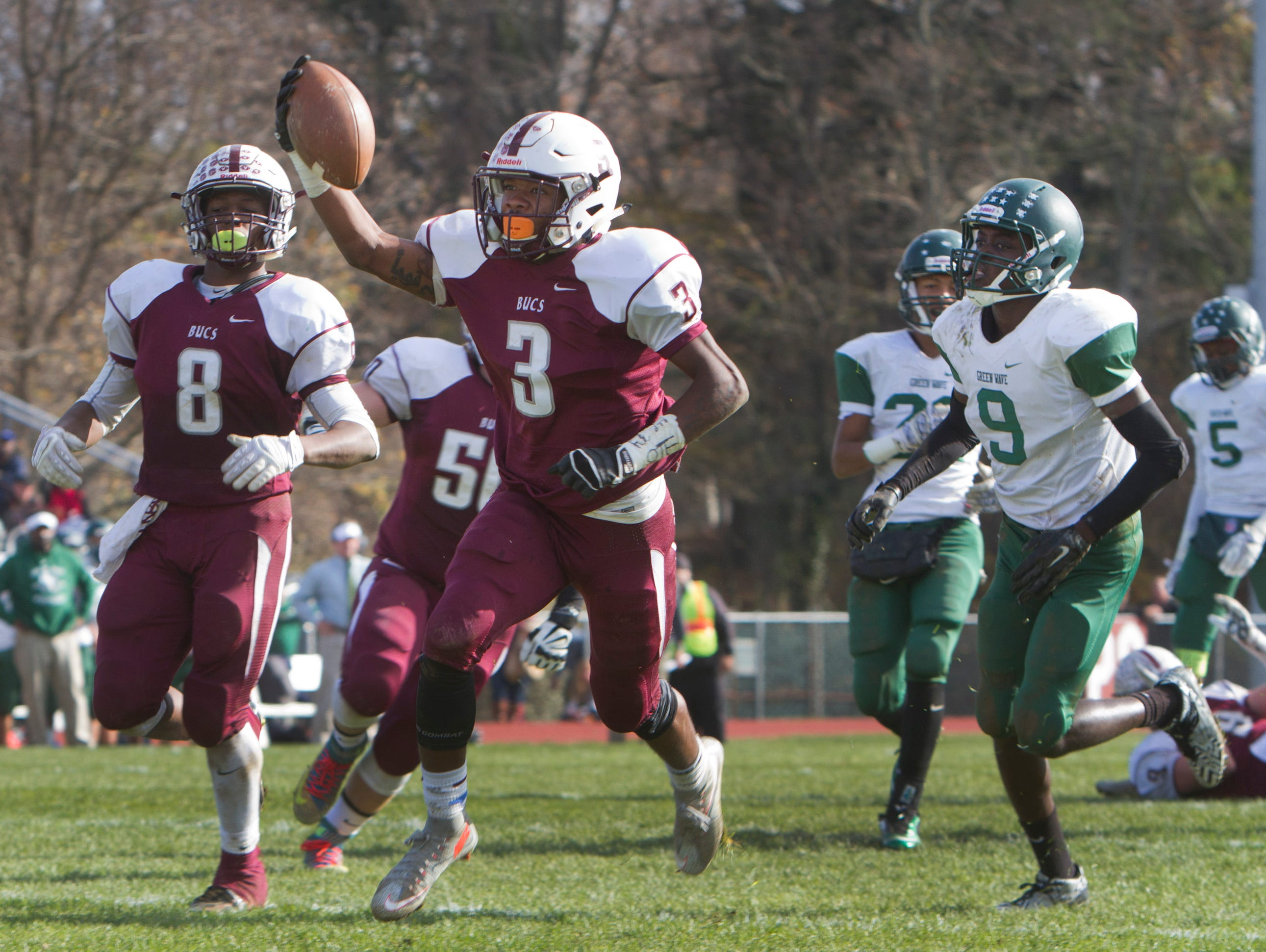 Red Bank Regional's Ben Sprauer raises the ball high as he heads for the enzone after getting through a hold up the middle for his team's second touchdown of game. Long Branch vs Red Bank Regional Thanksgiving Day Football game in Red Bank NJ on November 26, 2015.