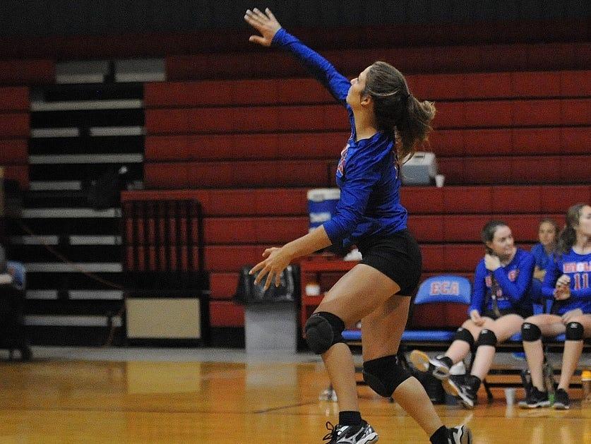 Evangel's Emily Deramus serves during her team's wom over Loyola on Tuesday night.
