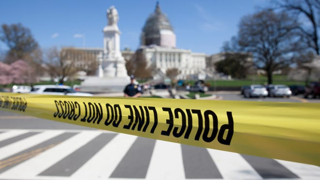 The north front of the U.S. Capitol is closed and a parameter created with police tape on Saturday, April 11, 2015, in Washington, D.C. Police say the U.S. Capitol is on lockdown as a precaution after shots were fired in what appears to be an attempted suicide.