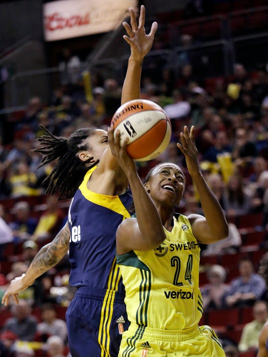 Seattle Storm's Jewell Loyd (24) shoots in front of Indiana Fever's Candice Dupree in the first half of a WNBA basketball game Sunday, May 14, 2017, in Seattle. (AP Photo/Elaine Thompson)