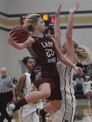 Station Camp's Emiline Payne drives but dishes off as Mt. Juliet's Emma Palmner defends in Mt. Juliet, TN on Fri. Jan. 13, 2017.  Photo by Dave Cardaciotto