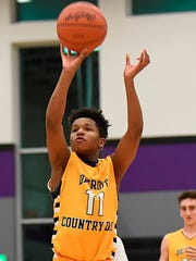 Freshman guard Wendall Green (11) led Detroit Country