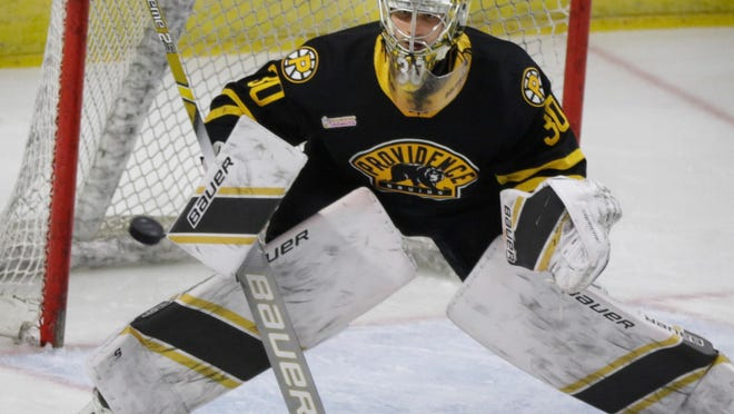 Dan Vladar guards the goal for the Providence Bruins during a game in April 2019.