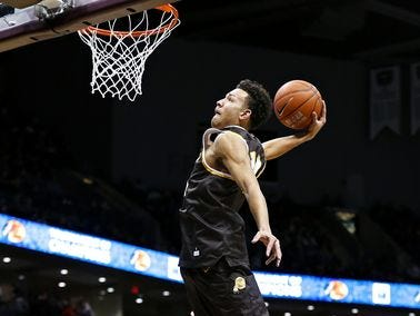 Kickapoo senior Isaac Johnson competes in the 2016 Bass Pro Tournament of Champions slam dunk contest at JQH Arena.