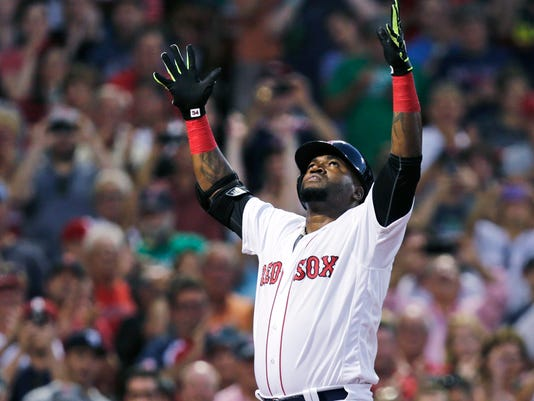 Boston Red Sox designated hitter David Ortiz raises his arms as he crosses home plate on his three-run home run off Detroit Tigers starting pitcher Mike Pelfrey during the third inning of a baseball game at Fenway Park, Tuesday, July 26, 2016, in Boston. (AP Photo/Charles Krupa)