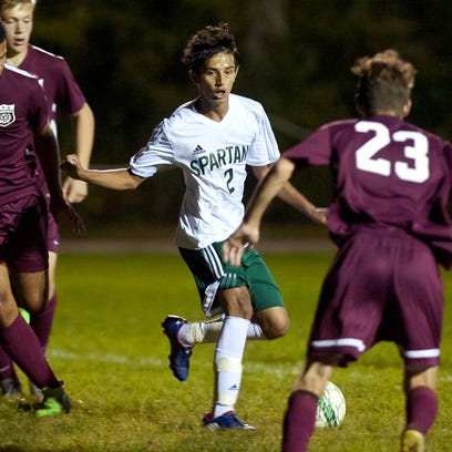 Winooski's Lek Nath Luitel, center, dribbles around