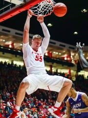 New Mexico's Connor MacDougall (55) dunks during the first half against Abilene Christian in Albuquerque, N.M., Wednesday, Nov. 30, 2016.