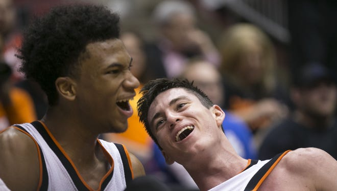 Corona del Sol's Marvin Bagley III and Alex Barcello  (right) celebrate winning the state championship game at Gila River Arena in Glendale on March 2, 2015.