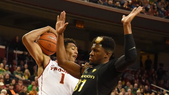 Feb 11, 2017; Los Angeles, CA, USA; Southern California Trojans forward Charles Buggs (1) battles for a rebound with Oregon Ducks guard Dylan Ennis (31) in the first half of a college basketball game at the Galen Center. Mandatory Credit: Richard Mackson-USA TODAY Sports