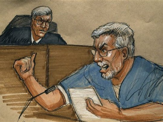 In this courtroom sketch, Drew Peterson (right) addresses the court and Judge Edward Burmila during Peterson's sentencing at the Will County Courthouse for the 2004 murder of his third wife, Kathleen Savio, on Feb. 21, 2013, in Joliet, Ill.