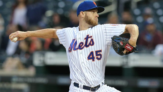 Jun 27, 2018; New York City, NY, USA; New York Mets starting pitcher Zack Wheeler (45) pitches against the Pittsburgh Pirates during the first inning at Citi Field.