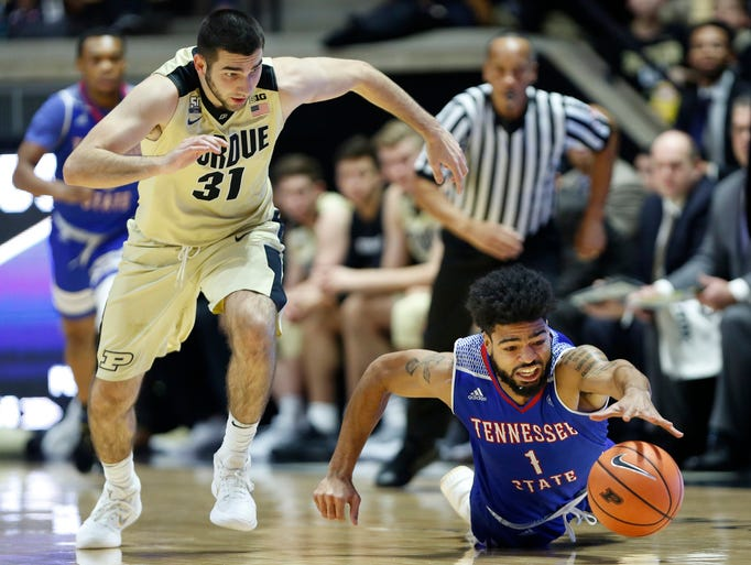 Dakota Mathias of Purdue chases the ball after knocking