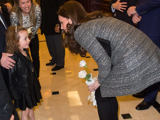 Kate greeted a young guest at the reception, Blake