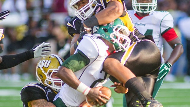 Edward Mosley (99) tackles Mississippi Valley quarterback Dontrinell Scott in game earlier this season.