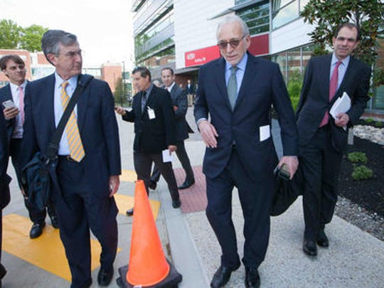 Nelson Peltz (right) leaves DuPont's headquarters after the proxy vote at last year's annual meeting.