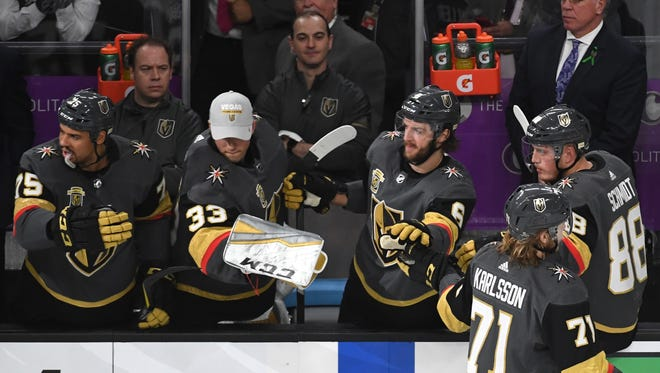 West Michigan natives Chris Davidson-Adams (back, left) and Pat Maino (back, right) are going to the Stanley Cup Finals as part of the equipment staff for the Las Vegas Golden Knights.