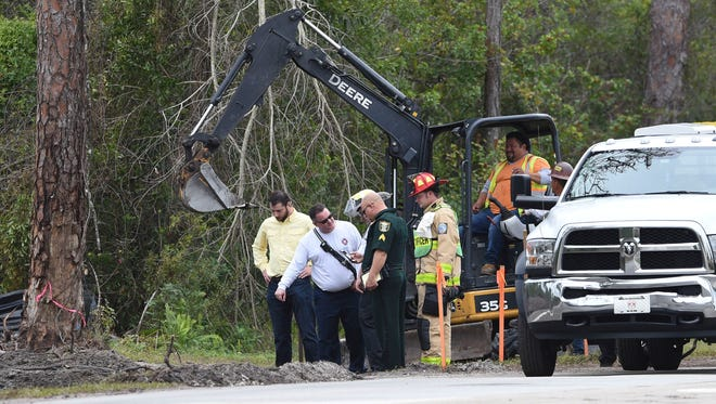 Martin County sheriff's and fire rescue officials inspect the scene of a gas leak Monday, Jan. 8, 2018, near Anderson Middle School in Stuart. Students were shuttled to Martin County High School and about 450 customers lost gas service that will be restored in a minimum of two days.
