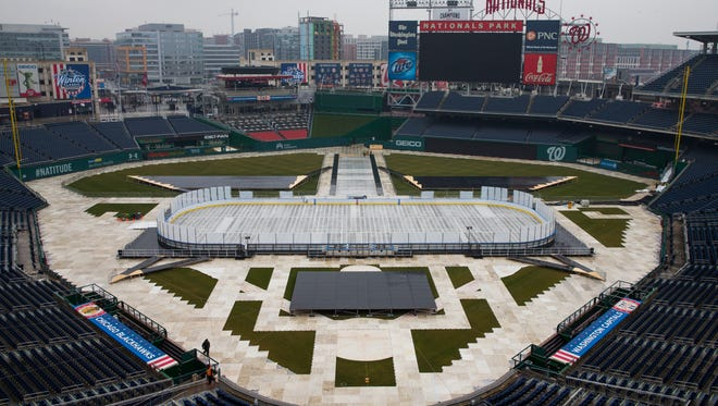 Construction crews work on preparing Nationals Park baseball stadium for the 2015 NHL Winter Classic, on Monday, Dec. 22, 2014, in Washington. The game between the Chicago Blackhawks and Washington Capitals will be played on New Year's Day.