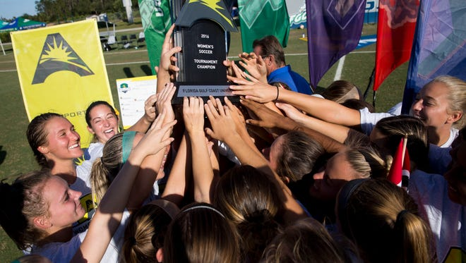 FGCU hoists the ASUN Championship trophy after defeating Lipscomb, 2-0, at the FGCU Soccer Complex Sunday, November 6, 2016.