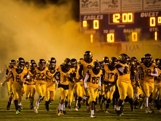 Northeast players storm their field with yellow dog