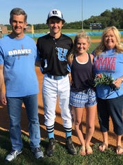 Luke Whitsell, senior at UCHS, poses for a picture with his family before the game Monday night.