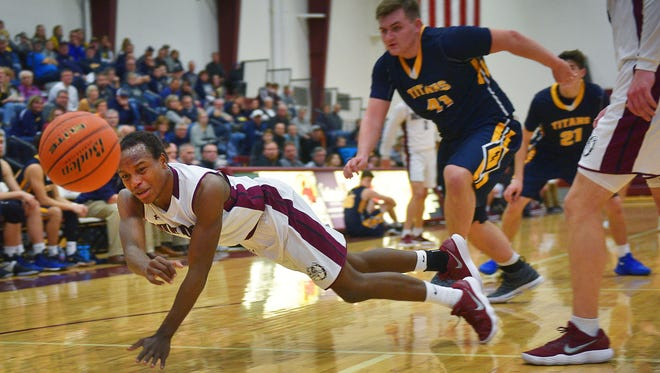 Madison's Doyle Brown attempts to gain control of the ball during the game against Tea Friday, Dec. 5, at Madison.