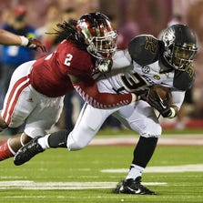 Indiana's T.J. Simmons (2) makes the tackle on Missouri's Russell Hansbrough (32) during the second half of the NCAA football game in Bloomington, Ind., Saturday, September 21, 2013. Missouri defeated IU 45-28. Doug McSchooler / for The Star
