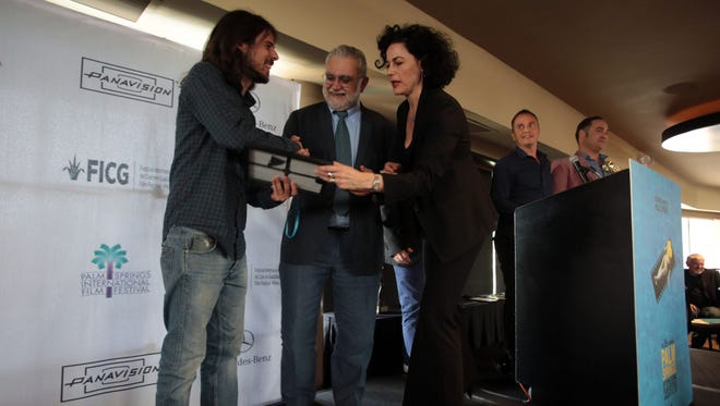 "Hermes Paralluelo, the director of ""Not All is Vigil"" is presented with the Cine Latino Award by Ivan Trujillo Bolio, the general director of the Guadalajara Film Festival, and Hebe Tabachnik, a programer with the Palm Springs International Film Festival at the 2015 at the 2015 Palm Springs International Film Festival Awards Luncheon. Film Festivals such as Palm Springs help promote diversity in the film industry."