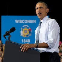 President Barack Obama waves to supporters after his arrival on Air Force One at the La Crosse regional airport in La Crosse on Thursday, July 2, 2015.
