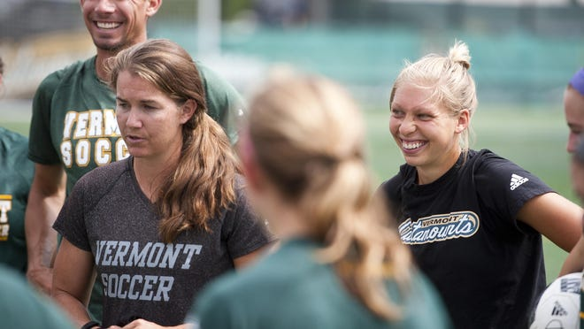 Vermont assistant coach Lauren Bernard, right, reacts as head coach Kristi Lefebvre, left, addresses the team at the end of a practice last week at Virtue Field.