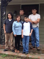 Members of the Ramos family posed for a portrait outside