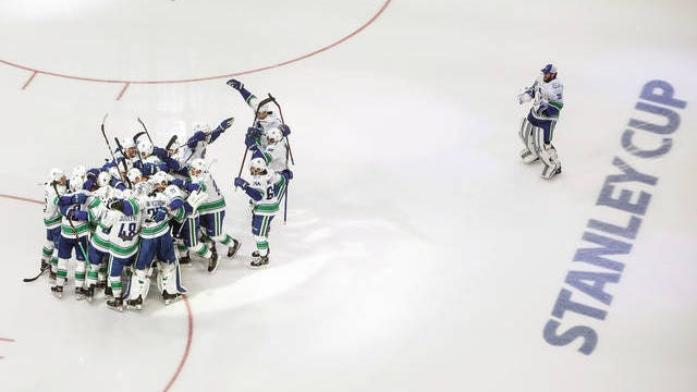 Vancouver Canucks players celebrate a goal against the Minnesota Wild during the third period of an NHL hockey qualifying round game, Friday, Aug. 7, 2020, in Edmonton, Alberta.