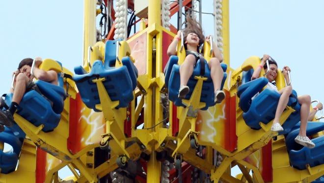 Riders plummet on the Mega Drop as the Cajun Heartland State fair continues Sunday, May 25, 2014, outside the Cajundome in Lafayette, La.