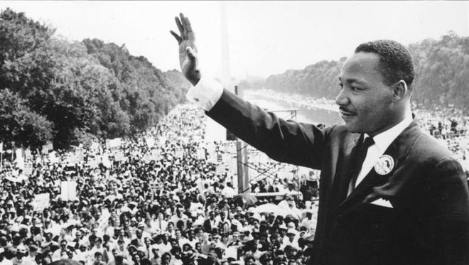 Martin Luther King Jr., who was born Jan. 15, 1929, waves to the crowd gathered at the 1963 March on Washington for Freedom and Jobs.