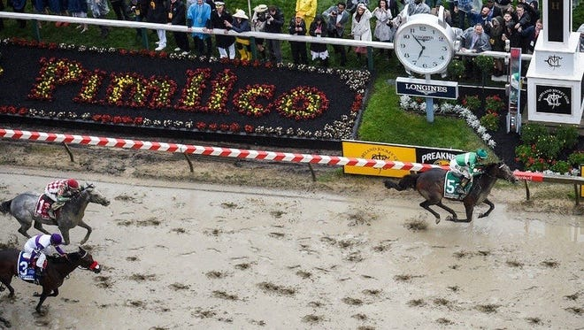 Exaggerator, right, beats Nyquist and Cherry Wine to the wire at the Preakness Stakes.