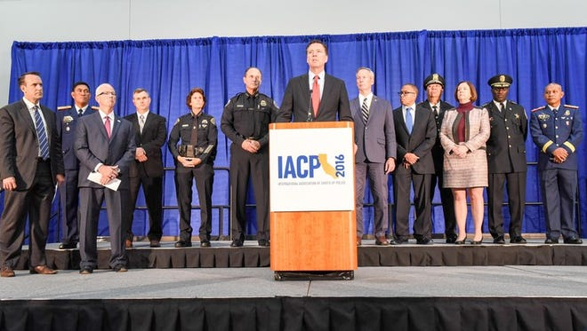 FBI Director James Comey, along with law enforcement partners, announces the results of Operation Cross Country X at a press conference in San Diego, California on October 17, 2016.