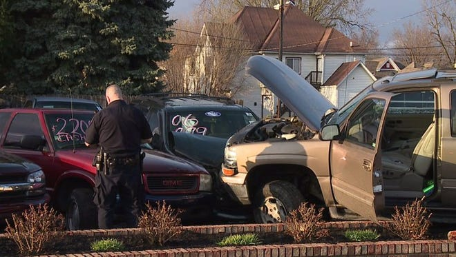 Officers arrested the driver of a stolen SUV after it crashed into a south side car lot Sunday night.