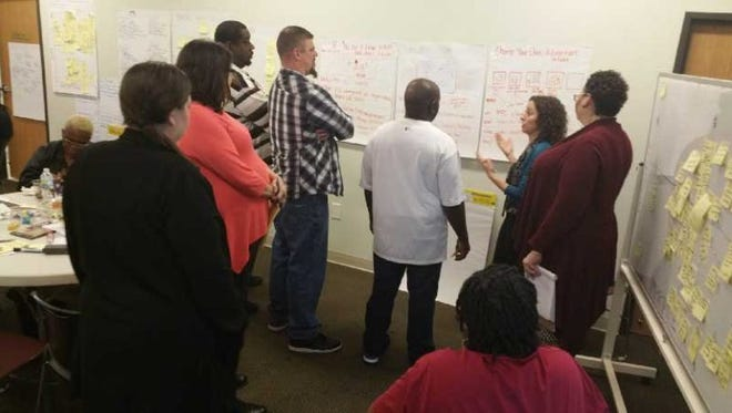 With funding from The Florida Bar Foundation, design teams for The Escambia Project map out new ways to deliver legal services to needy populations using input from clients of Pathways for Change in Pensacola.