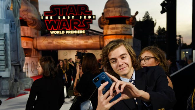 "Tyler Woodward, 17, of Reynoldsburg, Ohio, takes a selfie from his spot on the carpet at the premiere of the film ""Star Wars: The Last Jedi"" at the Shrine Auditorium in Los Angeles on Dec. 9. Woodward was one of seven teens with life-threatening medical conditions who were among the special guests at the premiere as part of the Make-A-Wish Foundation."