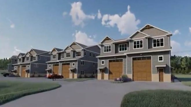A rendering shows what proposed new housing units, known collectively as the Trackside Townhomes, could look like someday. The housing is expected to be built just east of Road America near Elkhart Lake, Wis.