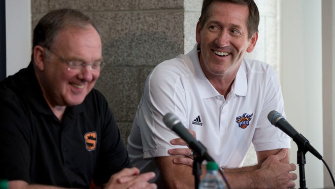 Phoenix Suns President of Basketball Operations Lon Babby (left) and coach Jeff Hornacek share a laugh during a press conference at US Airways Center in Phoenix on June 27, 2014.