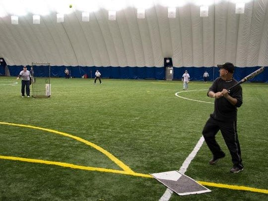 Eyeing a pitch is Trenton's Denny Latart, during a recent senior softball game at High Velocity Sports Dome in Canton.