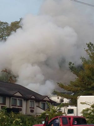 Smoke is seen pouring out of 3 Waldron Ave., Nyack, Tuesday, Oct. 13, 2015.