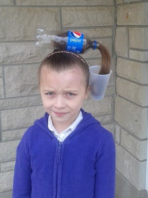 This photo of eight-year-old Peyton McCauley went viral after it was turned into an internet meme.