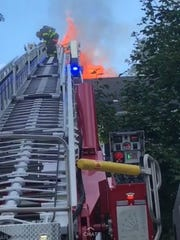 Flames were seen shooting from the roof of a home on