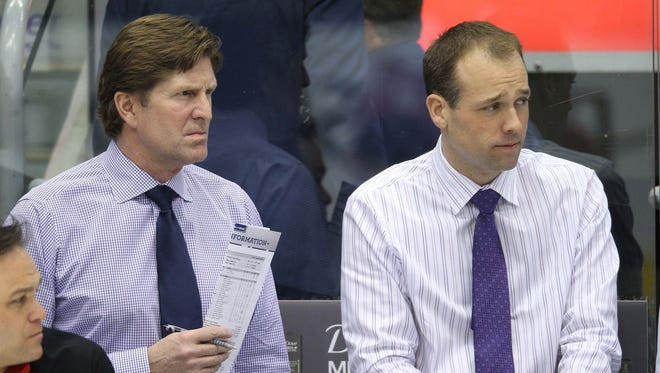 Detroit Red Wings coach Mike Babcock and assistant coach Jeff Blashill, right, look on before a game against the Toronto Maple Leafs at the Air Canada Centre in 2012.