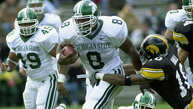 MSU's T.J. Duckett ran through and by and sometimes dragged defenders for three seasons in East Lansing.