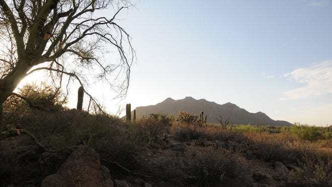Sunrise over Pass Mountain in Usery Mountain Regional Park in Mesa.