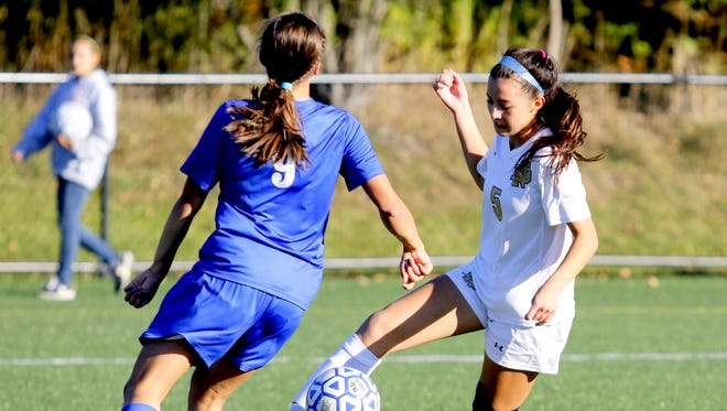 Notre Dame's Laurel Vargas controls the ball in front of Lansing defender Catalina Zaloj during the IAC Large School girls soccer championship game last year at Tompkins Cortland Community College in Dryden.