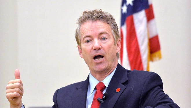 Kentucky Sen. Rand Paul speaks to the Chase Federalist Society at Northern Kentucky University on Friday, Nov. 21, 2014, in Highland Heights, Ky. Paul introduced a formal declaration of war against Islamic State terrorists Wednesday, Dec. 3, 2014.